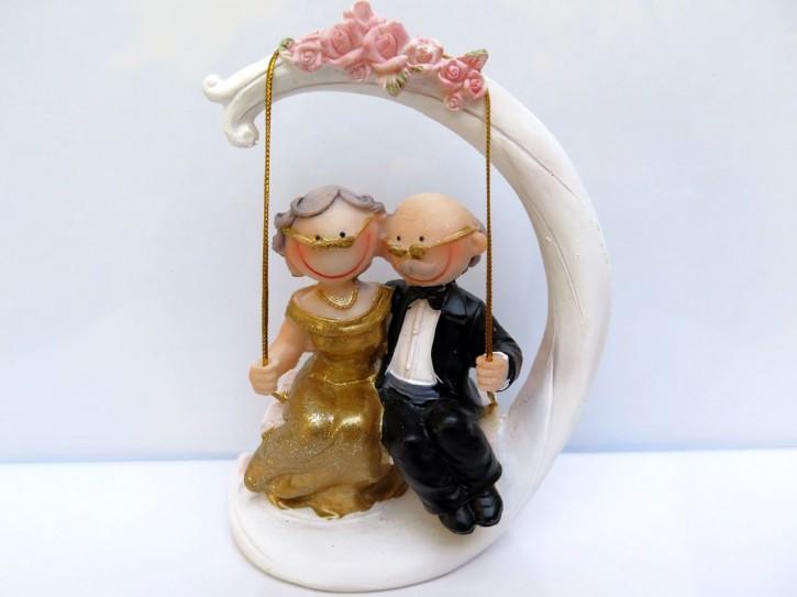 FI US Goldpaar Smile auf Schaukel