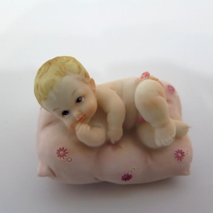 FI LO Baby auf Polster rosa B Seitenlage